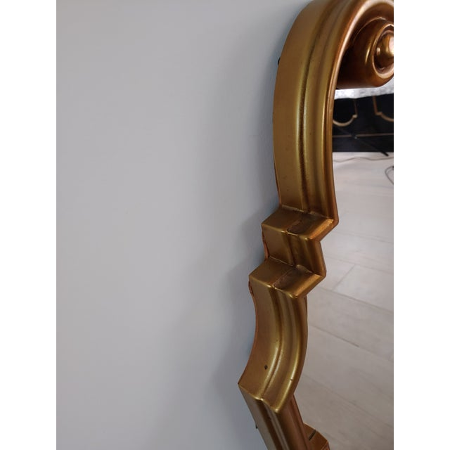 A pair of Hollywood Recency Queen Ann Mirrors with gold finish. Classic style mirrors that designers like Miles Redd...