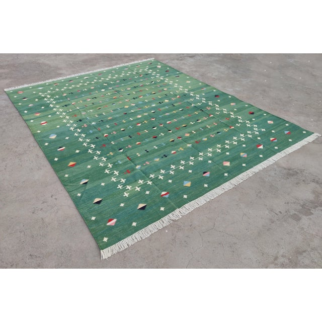 Cotton Vegetable Dyed Green Shooting Star Reversible Rug These special flat-weave dhurries are hand-woven with 15 ply 100%...