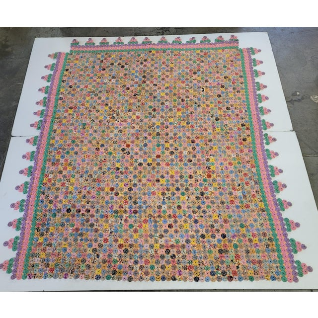 Yo-yo quilts are made from round pieces of fabric with long stitches along their turned-under outer edges. Stitches are...