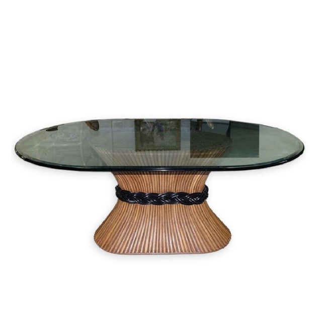 Mid Century Trompe L' Oeil Rattan or bamboo long oval Pedestal Dining Table with glass top by McGuire. This long piece can...