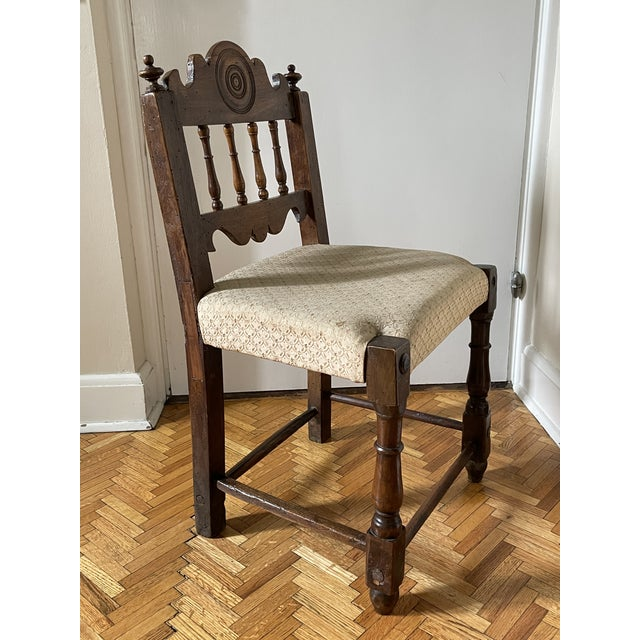 Rare 17th century Italian Florentine Hand Carved Upholstered Walnut Side Chair. The chair was upholstered in the 19th...