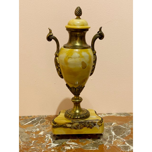 """A single marble Louis XVI style vase with pineapple finial and floral swags.. Circa 1900 Single 5.75"""" Wide x 4"""" Deep x 18""""..."""