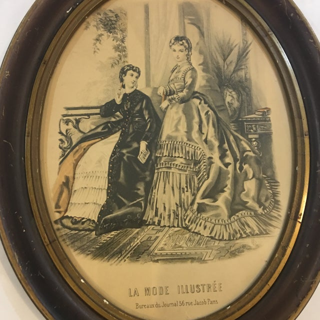 A very charming old 19th Century oval frame with French ladies wearing the latest fashions from a Paris vendor. A great...