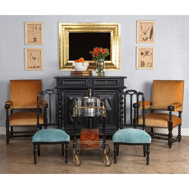 A pair of Napoleon III Chauffeuses, low chairs designed to sit by the fireplace. Made of ebonized pear wood and recently...