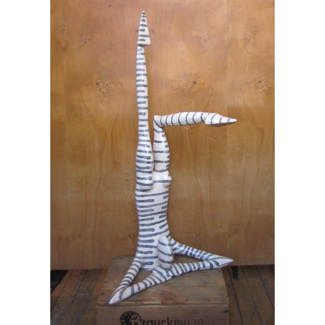 This is a playful, eye-catching contemporary (c. 1990s) postmodern style figural sculpture. The sculpture is by the...