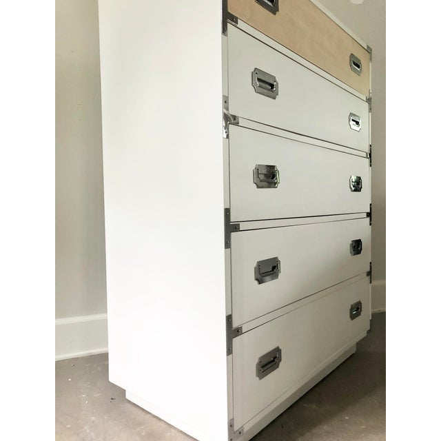 Finish: Snow white, durable polyurethane finish. Vintage Dixie Campaigner Dresser that has been renewed with a fresh and...