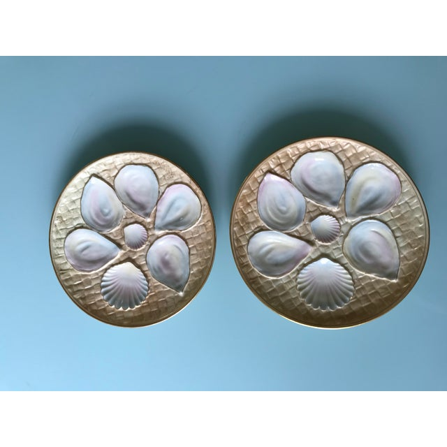 Beautiful pair of iridescent blush/ivory oyster plates. 7 oyster wells on a basket weave background with gilt rim. Royal...