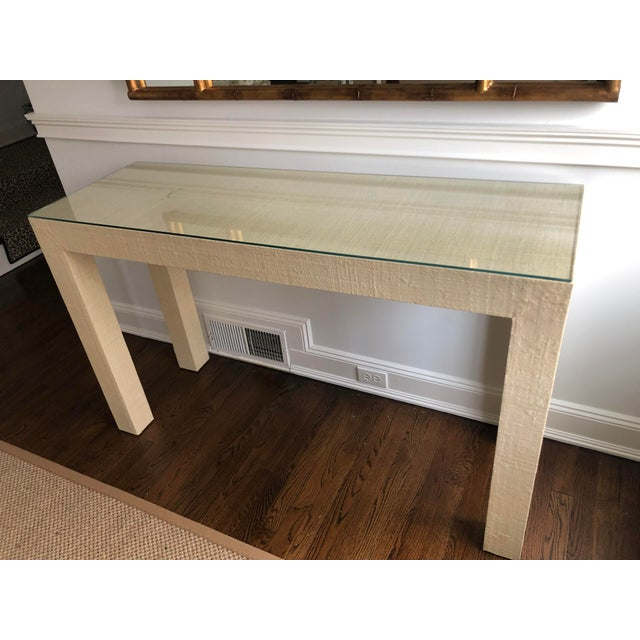 Brand new grasscloth wrapped parsons table console in natural color way. Also comes with custom glass protective topper.