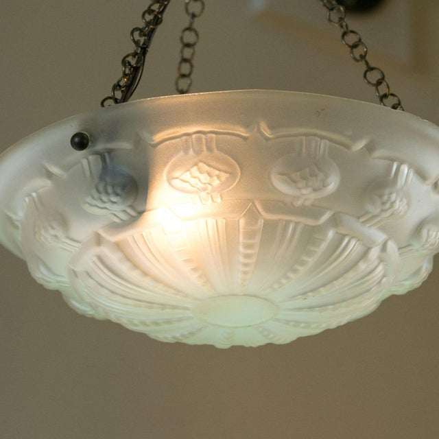 Art Deco frosted glass pendant or chandelier from France. The sweet light has been newly wired for use within the USA. It...