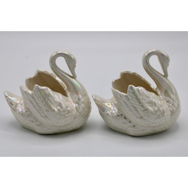 This is a pair of diminutive cream lusterware swan cachepots or planters, made in Holland circa 1940. Acute detail,...