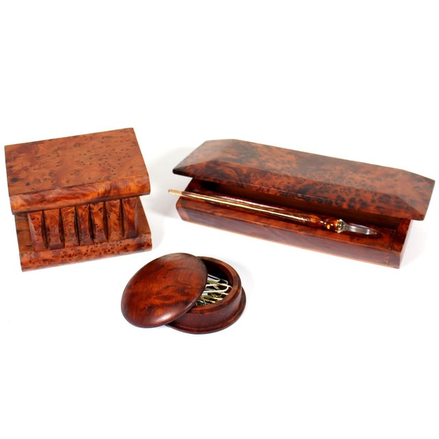 Set of 3 comprised of a stamp box in the shape of a book, pencil and pen box with a pen receptacle on top, and a round box...