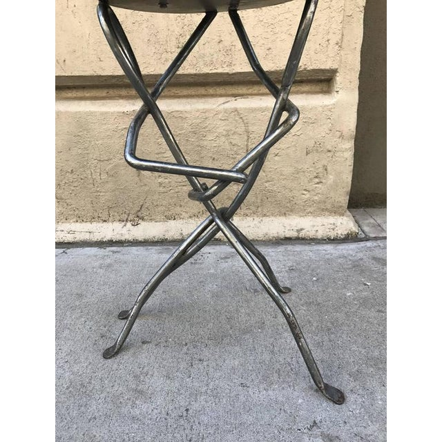 Sculptural Wrought Iron Stool with brown leather seat.