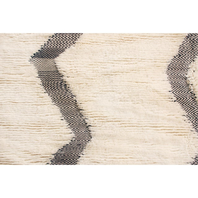 Originating from Morocco, this new geometric Moroccan rug from Rug & Kilim has distinct characteristics of recent...