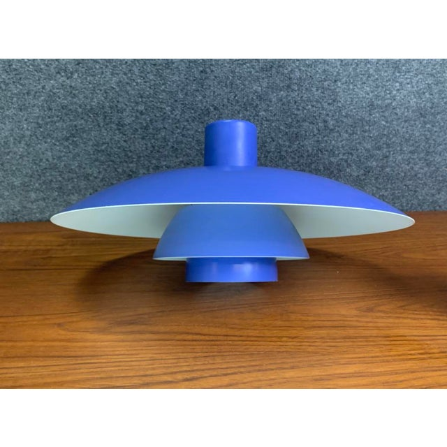 Here is a 1960's edition of the classic ph 4/3 metal pendant lamp shade in blue and white designed by poul henningsen for...