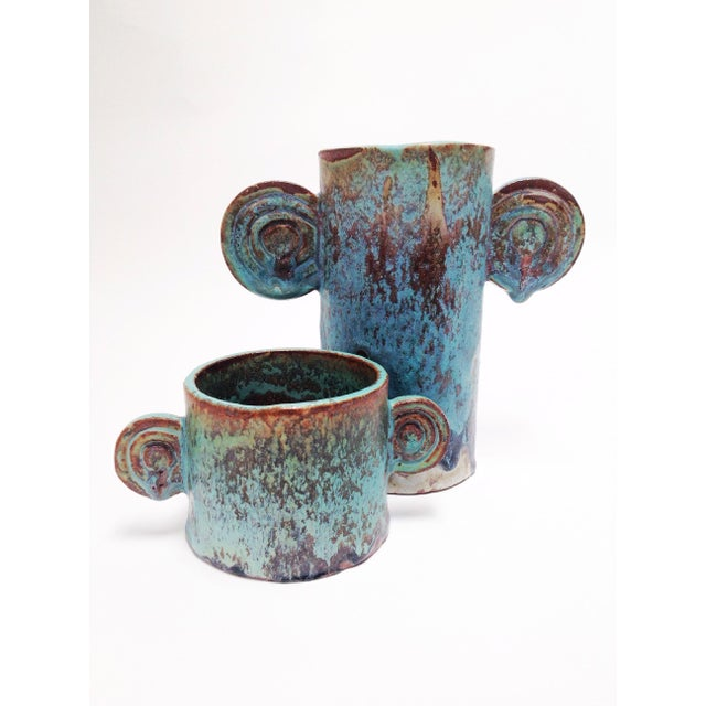 Give any room a distinct accent with these two spectacular turquoise vases. Wabi-sabi textured glaze. Large Size: can be...