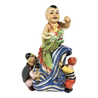 1920's Early Republic Chinese Neptunes Child Porcelain Figural Group With a Boy & His Green Dragon For Sale
