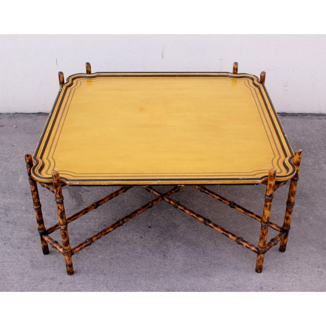 Gorgeous 1970s painted coffee table featuring a faux-bamboo base and removable scalloped tray top by Baker Furniture....