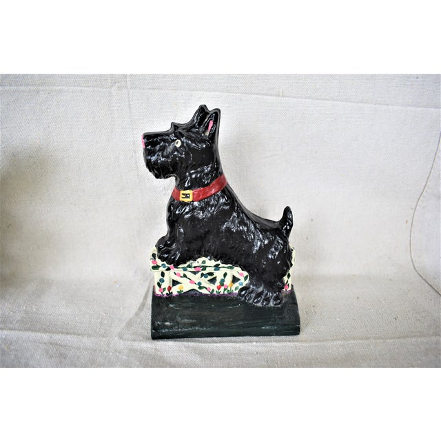 Heritage Metalcraft cast iron black Scotty doorstop. This Scotty stands ready to keep your door open! This is a pre-owned...