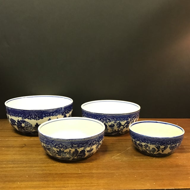 Beautiful set of 4 Moriyama blue willow serving bowls from the early 1900s. No chips or cracks, some crazing and yellowing...