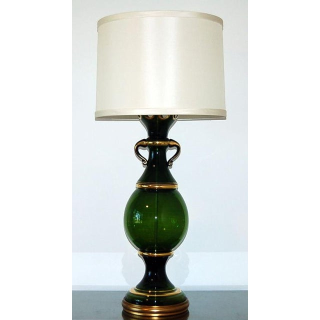 Vintage Venetian glass table lamp - so large, a pair becomes unnecessary. Curvaceous glass edged in gold and topped with a...