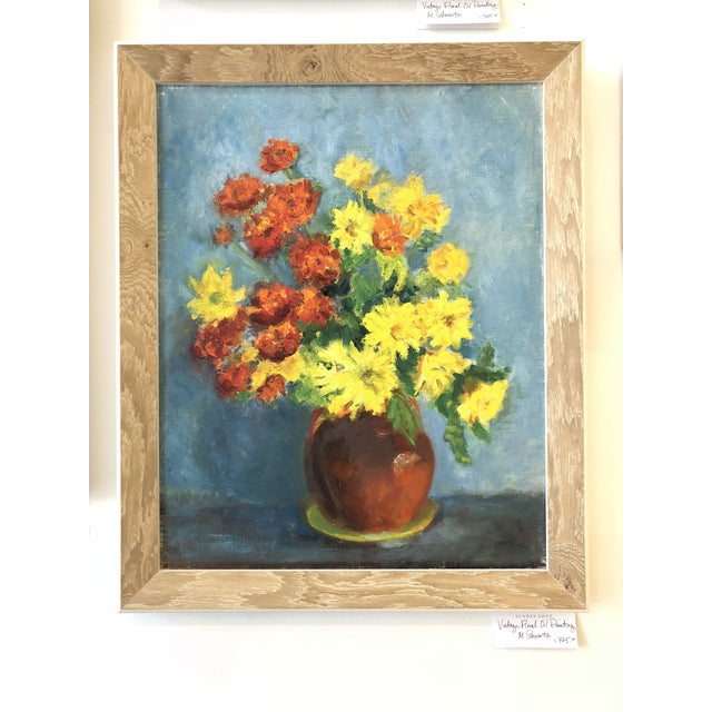 This Impressionist still life painting features a red vase full of assorted yellow and orange flowers. Each detailed...