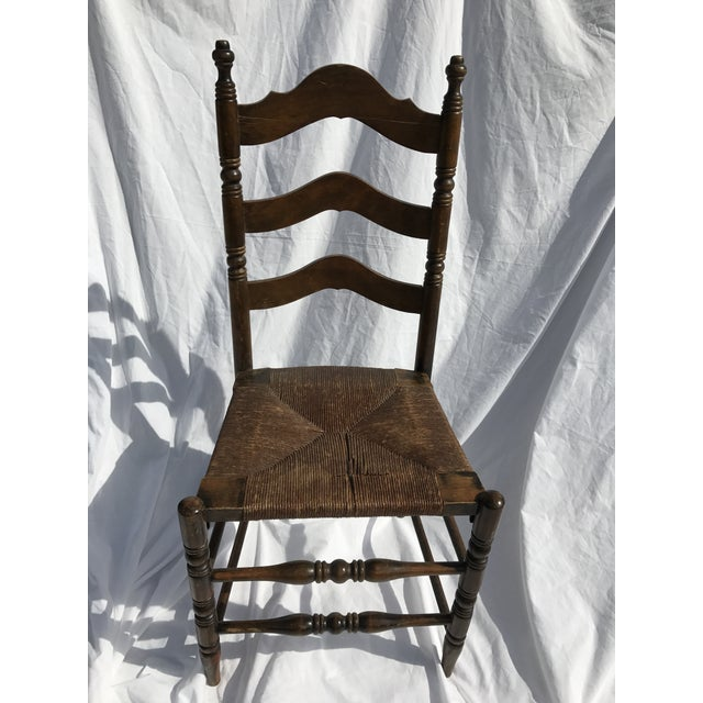 This beautiful, antique, Ladder Back, Rush Seat, Side chair of dark oak is solid, sturdy and stunning. Although six or so...