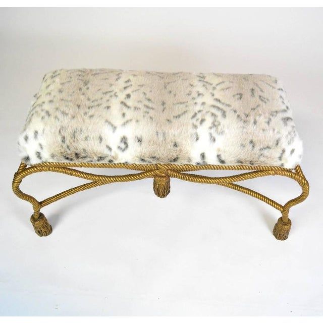 An Italian bench with Sahco faux lynx fur seat on a gilt rope and tassel base. Wonderful size.