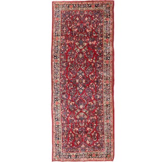 Antique Sarouk Long Gallery Runner With All-Over Flower Design in Red Background For Sale