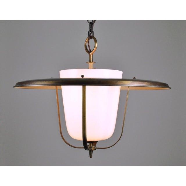 White glass and brass indoor lantern from the Bronzewarenfabrik workshop in Turgi Switzerland. Designed and manufactured...