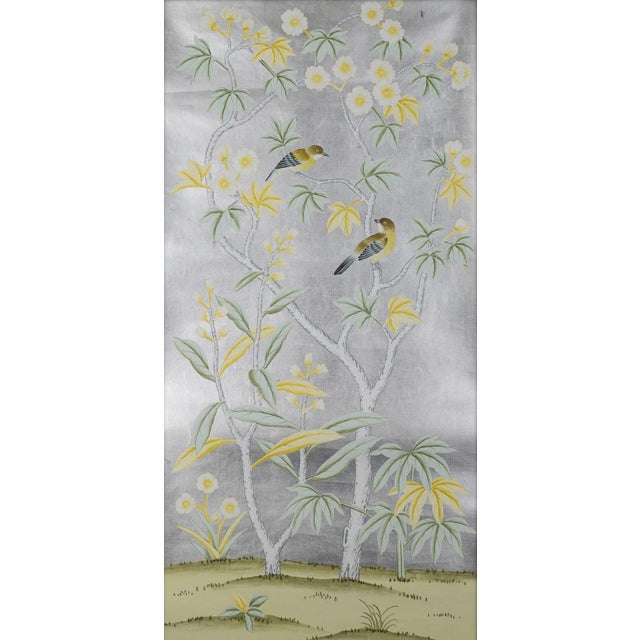 Painted on hand-applied silver leaf squares, this diptych (pair) of panels feature traditional Chinoiserie botanicals that...