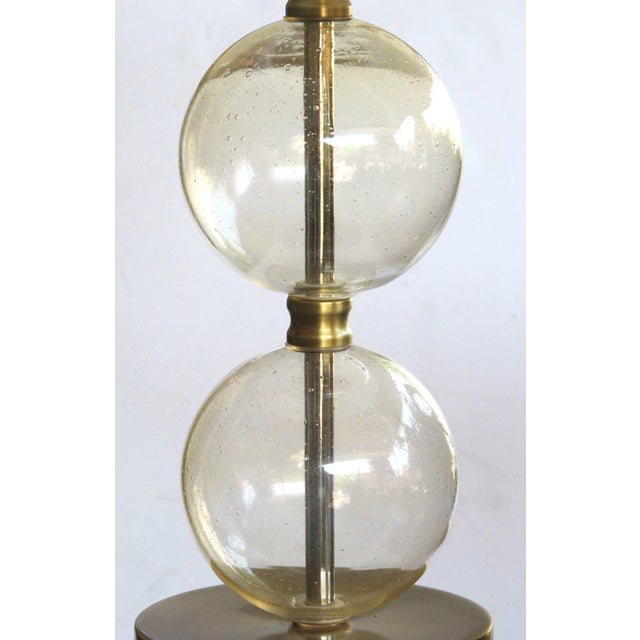 A striking Murano mid-century lamp of stacked gold orbs; consisting of 2 large glass orbs resting on an over-scaled...