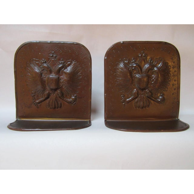 This pair of circa 1900-1910 bookends are a great example of the Mission, Arts and Crafts period, with the Double Headed...