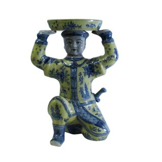Oriental Vintage Ceramic Yellow Blue Flower Man Holding Dish Figure For Sale