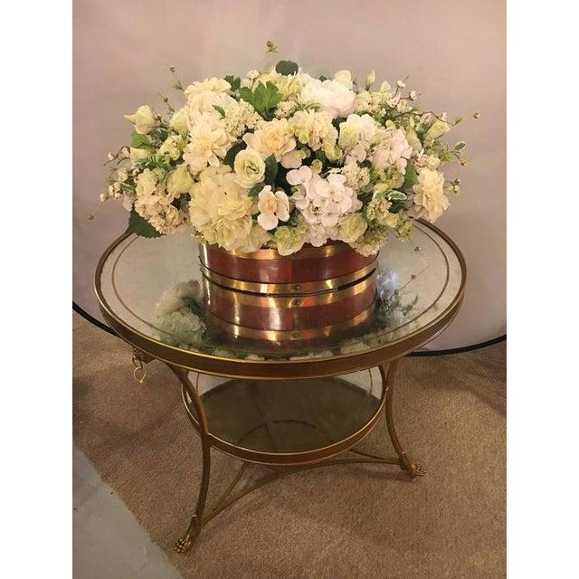 Gilt based églomisé and mirror top gueridon centre table. This wonderfully stylish and desirable centre table has the...