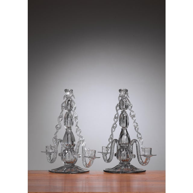 A pair of glass candelabra, designed by Gerda Strömberg and executed by masterblower Knut Bergqvist for Strömbergshyttan...