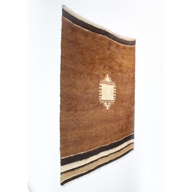 Woven entirely by hand on simple wooden looms with mohair wool from their Angora goats, the semi-nomadic Yoruk tribes in...
