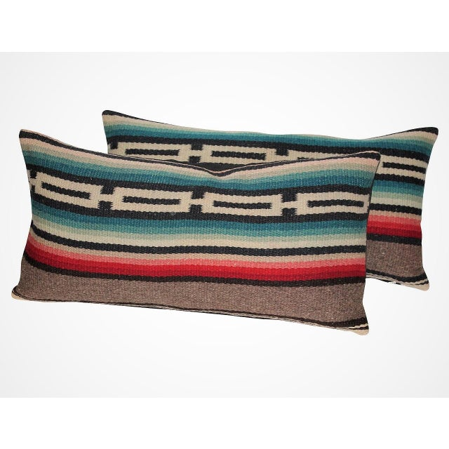 This fun and colorful pair of bolster pillows are from a serape weaving. Sold as a pair. The backing is in black cotton...