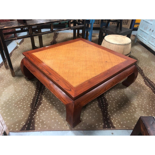 Beautifully handcrafted coffee table with cane top. This walnut finished coffee table has chunky Ming style legs and a...