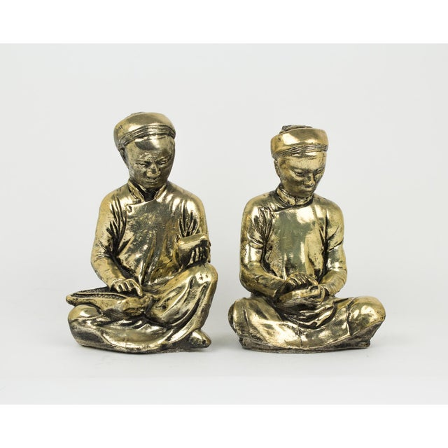 Beautiful pair of reading / studying monk statues or figures. Antique gold pain with a patina effect. Made out of plaster...