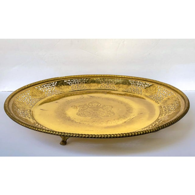 Large and visually unusual pierced brass round footed tray or shallow bowl with a center engraved design of Buddha,...