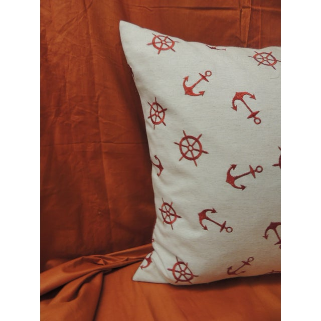 Red and natural embroidered nautical decorative pillow with solid red backing. Decorative pillow square designed in the...