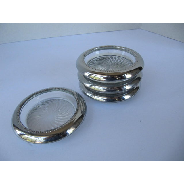 Set of 4 Mid-century glass and silver-plate coaters. Great for parties or everyday to preserve your furniture. Some wear...