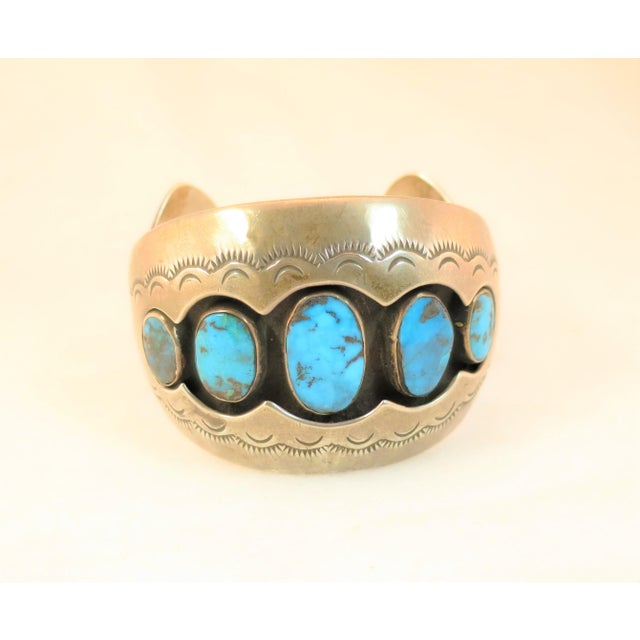 Offered here is a Native American Zuni sterling silver and turquoise cuff bracelet crafted by Mabel Watson in the 1970s....