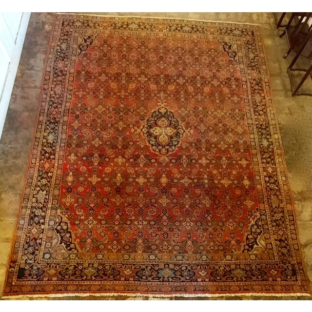 Vintage Persian Sarouk Rug- size 9x10 ft Wool on cotton foundation, central medallion on a densely decorated burgundy...
