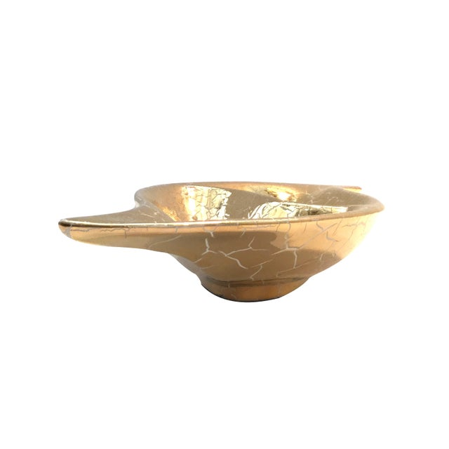 This Vintage Gold Leaf Dish definitely catches the eye. It would be perfect place to store small items or used for serving.