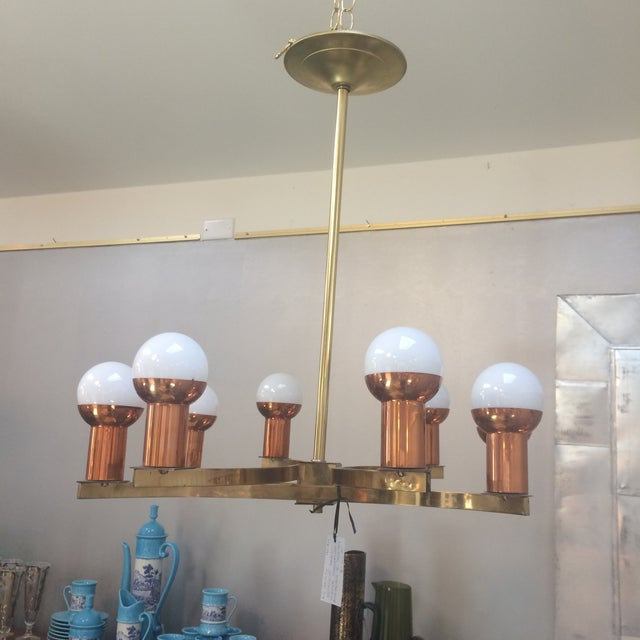 A rare Mid-Century Modernist 8 Light Chandelier attributed to Sciolari Lightolier. Made of Brass and Copper which is very...