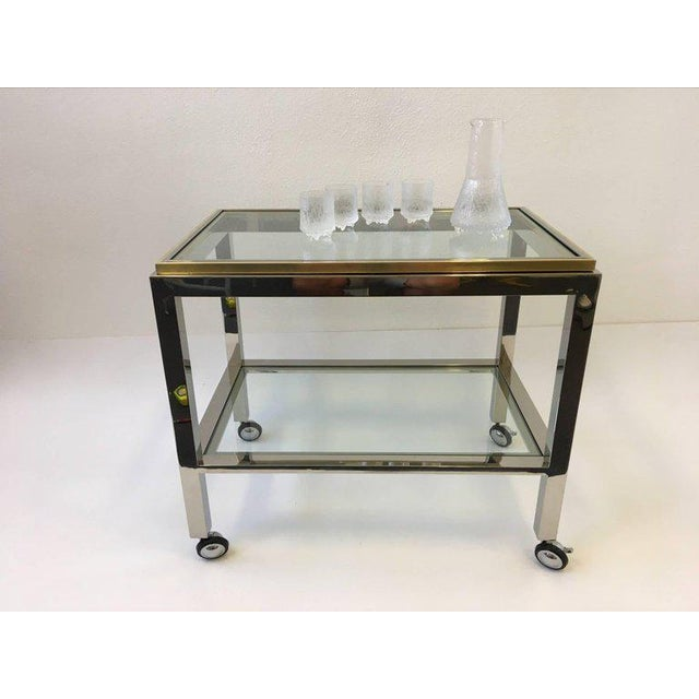 A glamorous polished chrome and brass with glass inserts Italian bar cart designed in the 1970s by Renato Zevi for Zevi &...