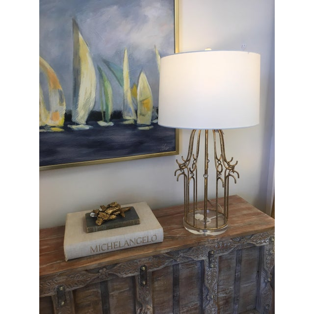 Stella Table Lamp features a metal frame, finished in Glazed Silver and detailed with small crystal glass spheres. Made...