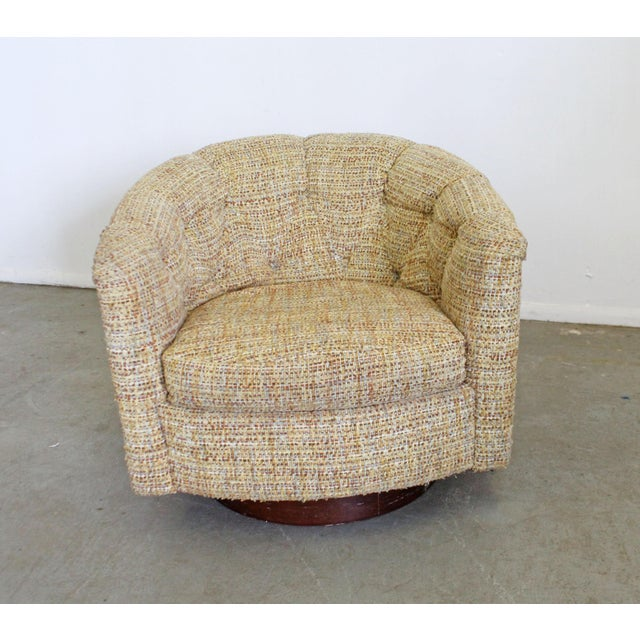 What a find. Offered is a mid-century modern barrel-back swivel chair by Milo Baughman for Thayer Coggin. Has a wooden...