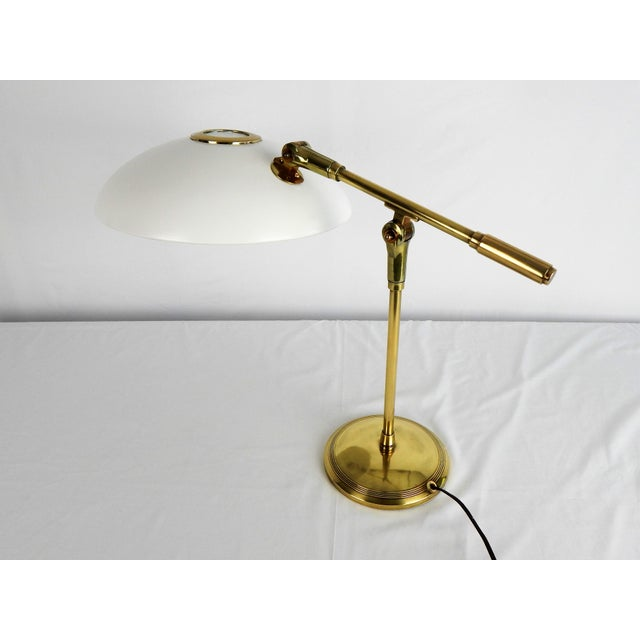 Iconic Mid-Century Saucer desk lamp with adjustable solid brass arm and base. Original US wiring in working order....
